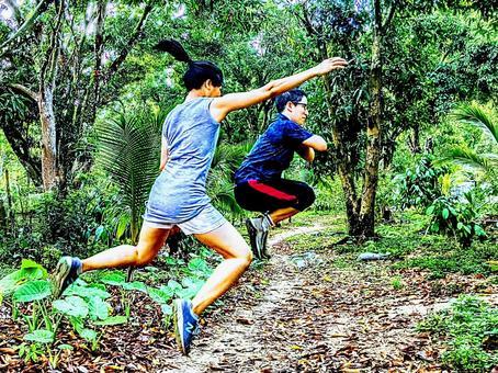 A woman sandwiching a man while jumping