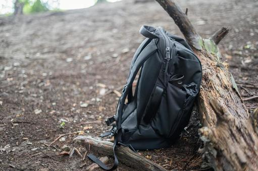 A backpack that a climber put on the ground during a break