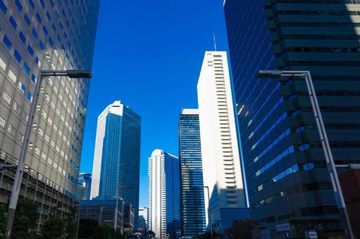 Skyscrapers in Nishi-Shinjuku towering against the blue sky (Gijido Street)