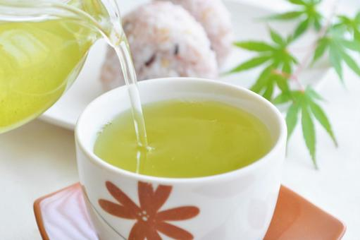 Pour green tea (tea) from Kyusu into a teacup. Millet rice ball Lunch Japanese food image