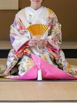 Bride with folding fan