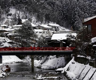 Snow and red bridge