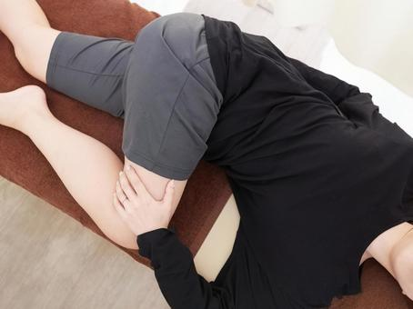 Japanese woman doing self-stretching of the lower body