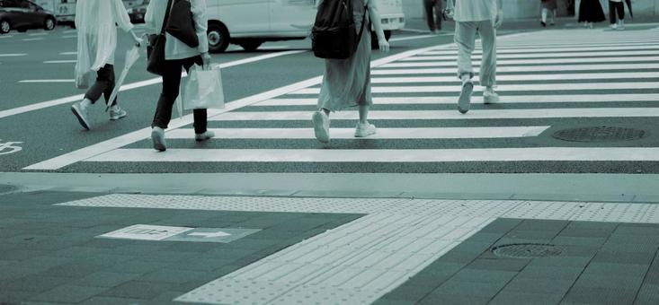 Woman crossing the signal