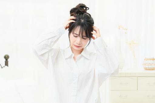A young woman in a white shirt making a gesture that is worried in the room