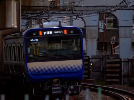 Yokosuka Line new train E235 series that runs in downtown at twilight