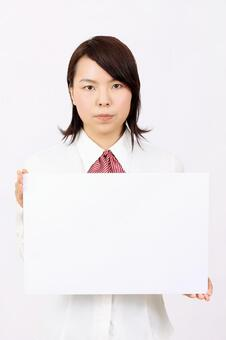 A woman with a whiteboard