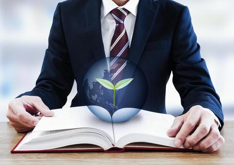 A businessman and a leaf opening a thick book