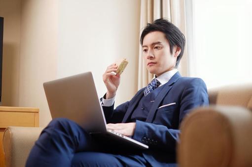 Hotel man using a laptop 13