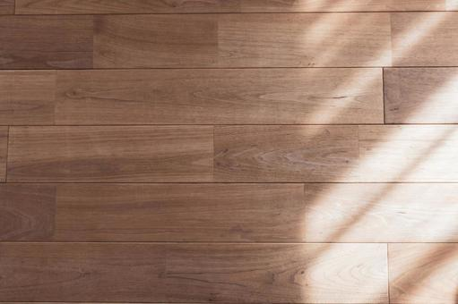 The contrast between the light and shadow of the solid floor where the sun shines