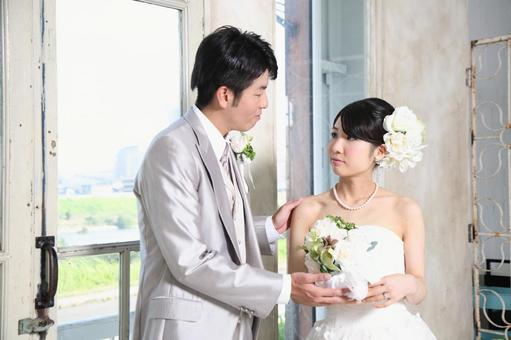 Bride and bridegroom staring together 1