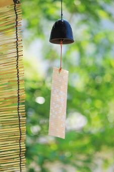 Summer days and wind bells vertical
