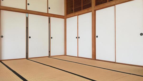 Japanese-style room with white fusuma and tatami