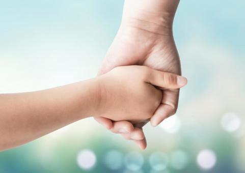 Parent-child image of holding hands Glitter background