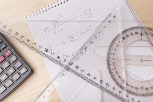Protractor and triangle ruler, notebook and calculator