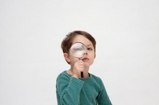 Magnifying glass and a boy 2