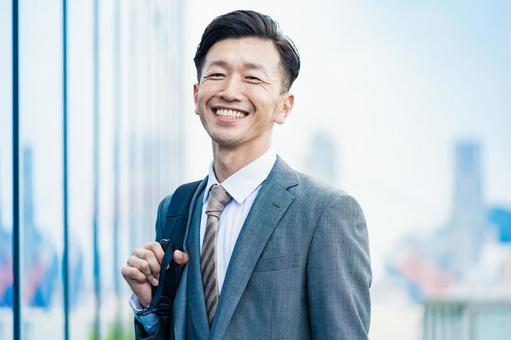 A businessman who commute with a smile