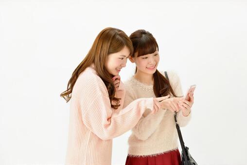 Two people girl watching smartphone 1