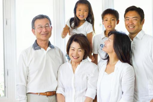 Japanese 3rd generation large family portrait looking at the camera
