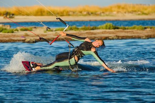 Woman doing kitesurfing