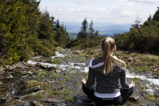 A woman practicing yoga in Sawa 11
