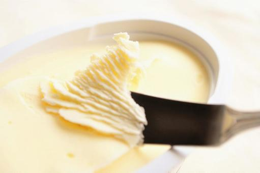 Butter knife and butter close-up