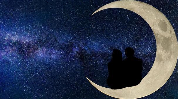 Couple sitting on the moon