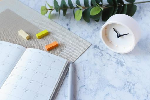 Schedule book and clock