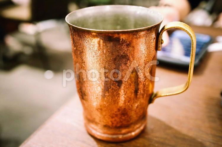 小物 雑貨 飲み物 ー カフェで出てきた冷え冷えの飲み物の写真