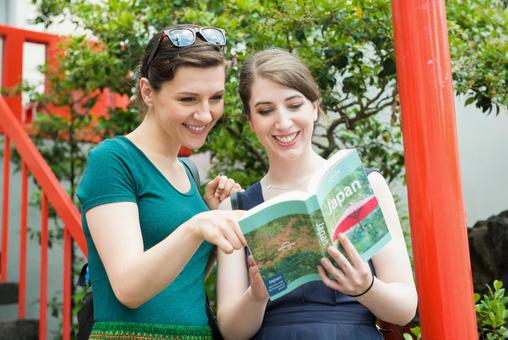 Watch a guidebook Female foreign tourist 1