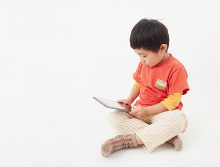 Toddler / tablet viewing image on white background