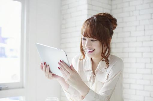 Woman watching tablet 6