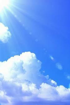 Blue sky, white clouds and dazzling sun shining summer sunshine summer sky