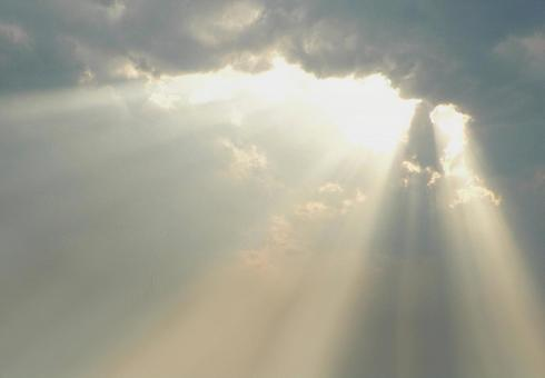 A divine light leaking through the gaps in the clouds as if God had descended