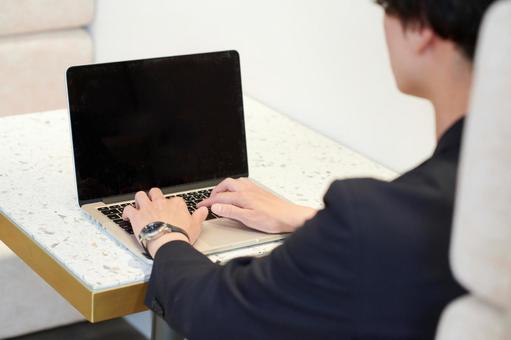 A man using a laptop in a meeting space