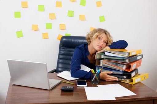 Working mother at work at the desk in front of the wall with many sticky notes 12