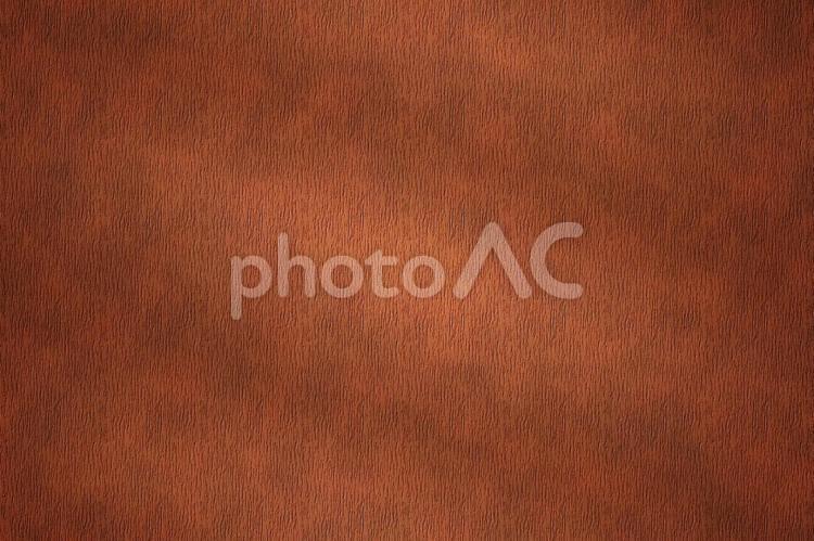 背景素材 ー ライトに照らされた水シボ牛革/茶色/ブラウンの写真