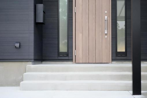 Newly built black single-family approach and entrance