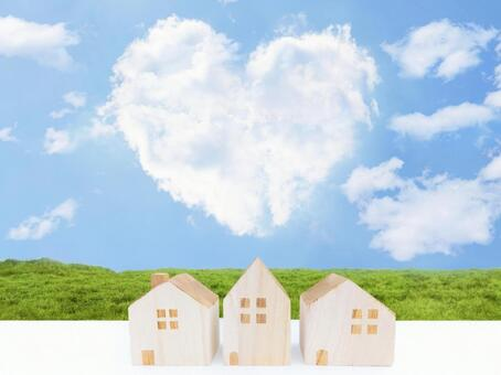Heart-shaped clouds, blue sky and house