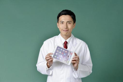 Male in white coat with iPad 3