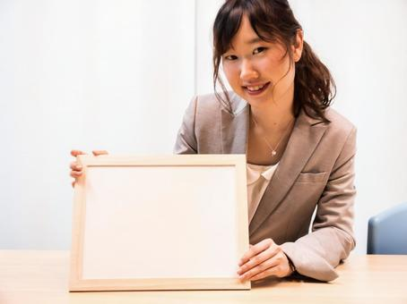 A woman with a white board