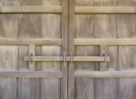 Wooden door with a bar