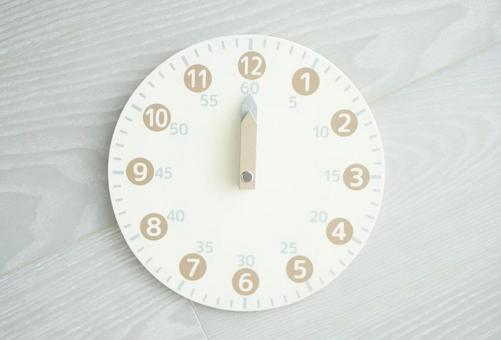 Toy analog clock 12 o'clock