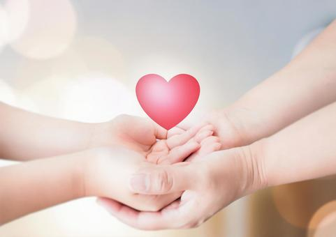Parent-child hands and heart