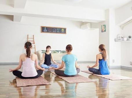 Asian woman meditating with yoga