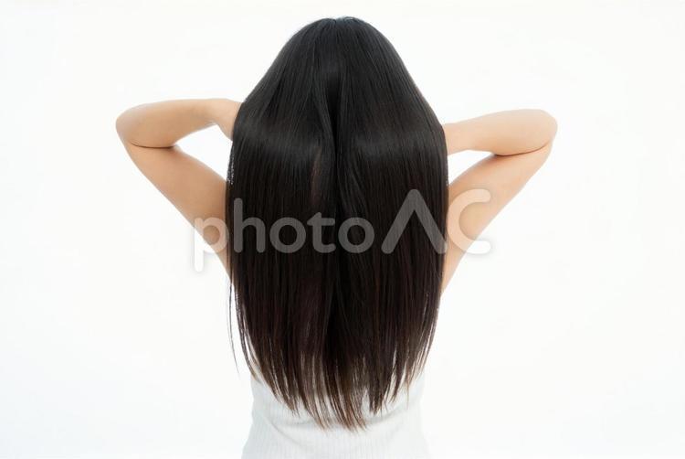 髪のイメージ 女性の長いストレートヘアの写真
