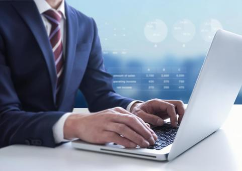 Business image with a man operating a PC