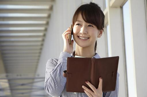Japanese speaker speaking on smartphone OL 14