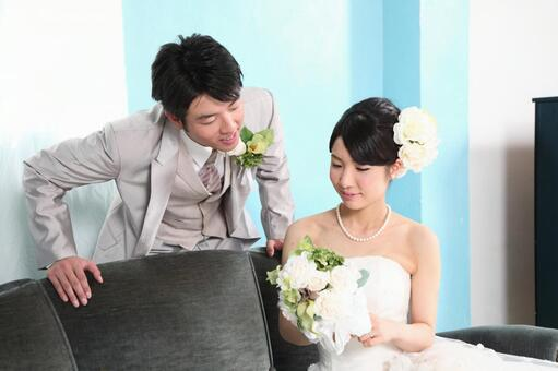 Bride and groom sitting on the sofa