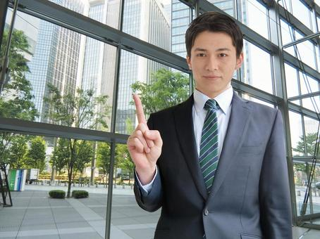 Man pointing to business point-